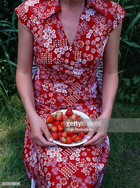 Woman Sitting with Plate of Strawberries