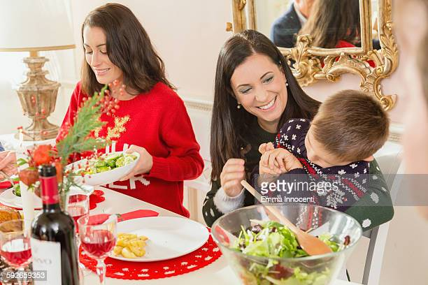 Woman sitting with son at Christmas dinner