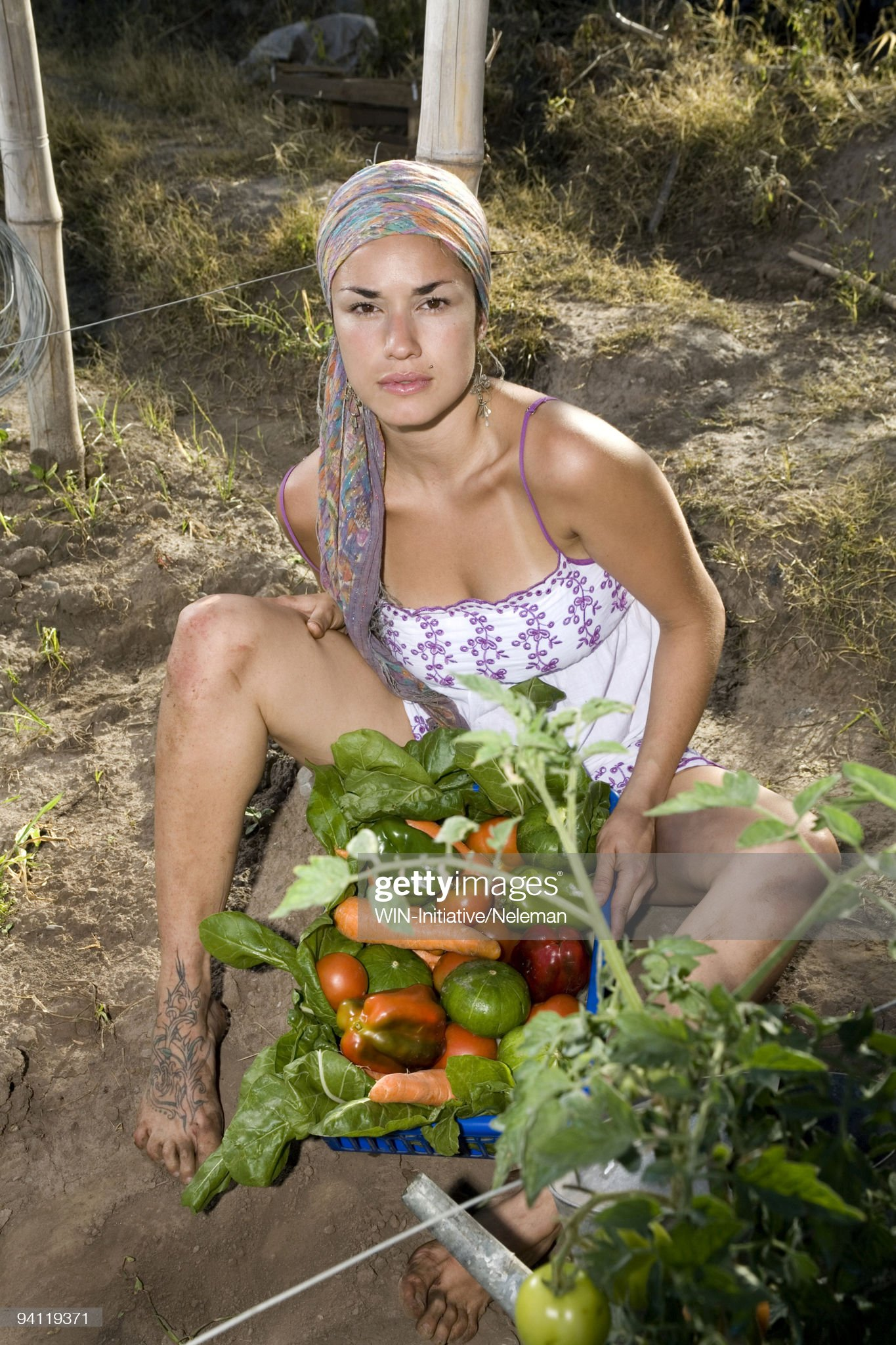 https://media.gettyimages.com/photos/woman-sitting-with-vegetables-in-a-field-tucuman-argentina-picture-id94119371?s=2048x2048