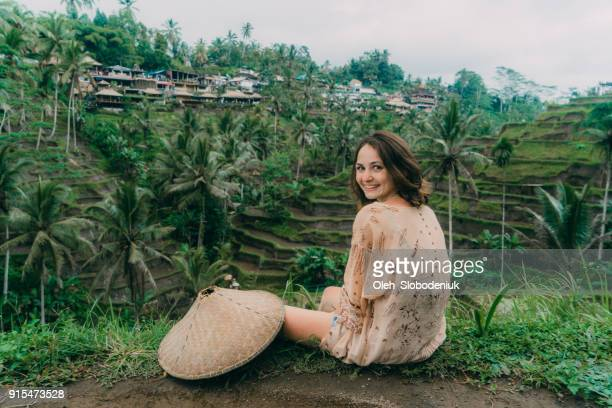 Woman sitting with view  on Tegallalang rice field in Bali, Indonesia