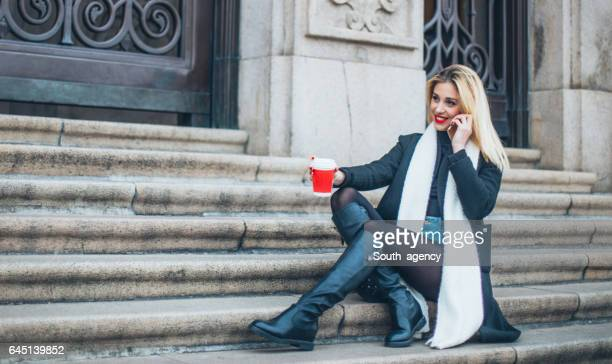 Woman sittting on steps