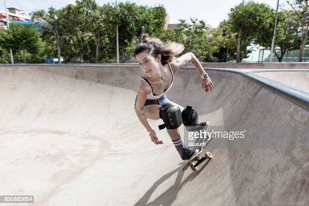 Woman skateboarding in skatepark