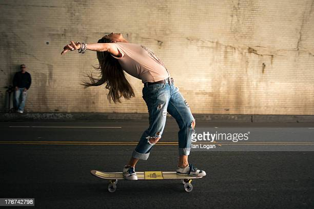 woman skateboarding in tunnel - ungestellt stock-fotos und bilder