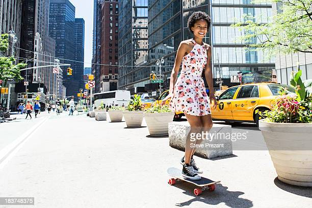 woman skateboarding - sundress stock pictures, royalty-free photos & images