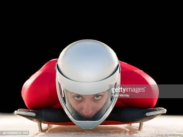 Woman skeleton athlete in crash helmet on skeleton, portrait, close-up