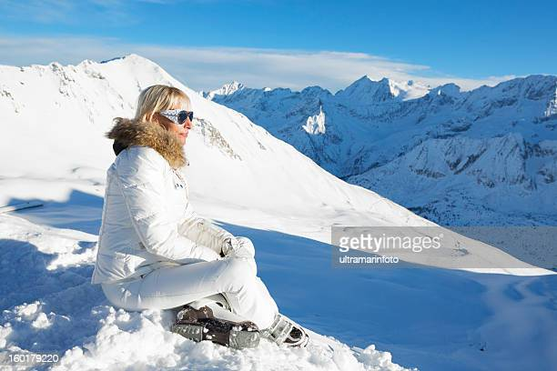 Woman skier  at the top of a snowy  mountain
