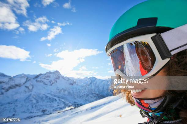 woman skier skiing at sunny ski resort amateur winter sports on the top - ski goggles stock pictures, royalty-free photos & images