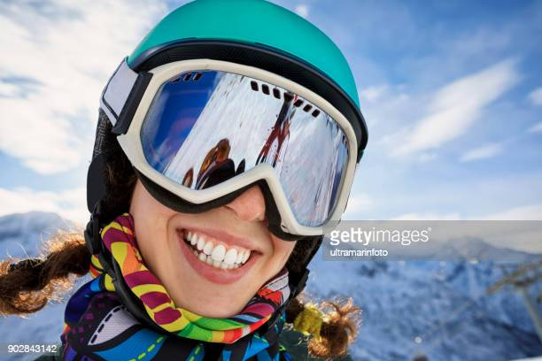 Woman skier skiing at sunny ski resort Amateur Winter Sports On the top