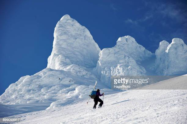 Woman skiers ascends the Northeast flanks of Mt Augustine