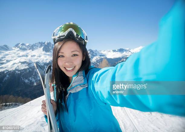 Woman skiing and taking a selfie
