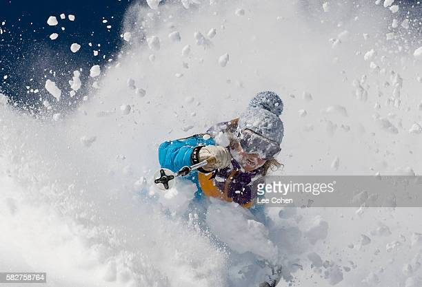 woman skiing deep powder at alta, utah - skiing stock pictures, royalty-free photos & images