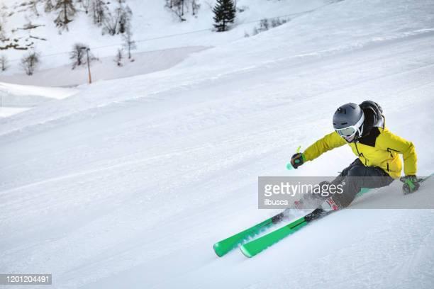 woman skiing in alps ski resort, alpe di mera, piedmont, italy - ilbusca foto e immagini stock