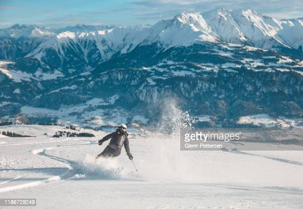 woman skiing in laax, switzerland. - northern european descent stock pictures, royalty-free photos & images