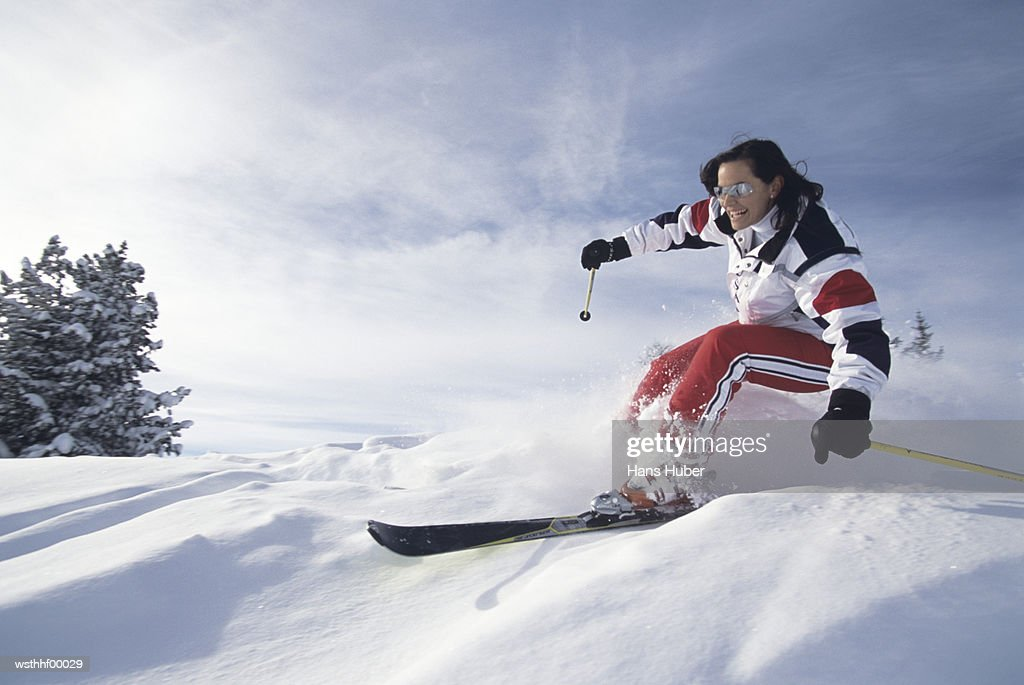 Woman skiing in snow : Stock Photo