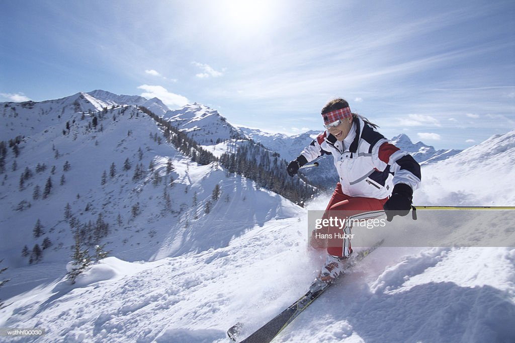 Woman skiing in snow : Photo