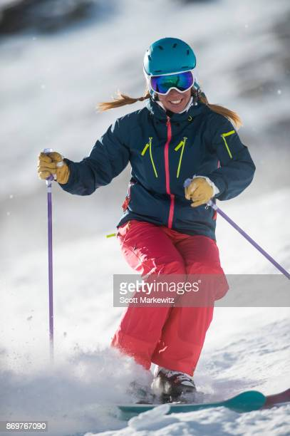 A woman skiing on a sunny winter day