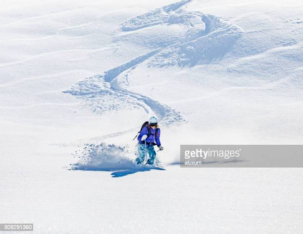woman skiing on deep snow - alpine skiing stock pictures, royalty-free photos & images