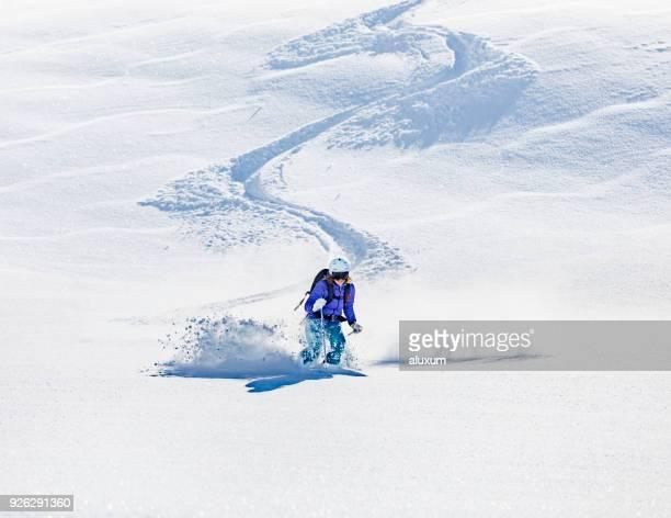 Woman skiing on deep snow