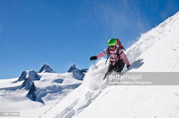 Woman skiing on snow, Chamonix, France