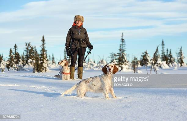 Woman skiing with her dogs, Synnfjell Norway