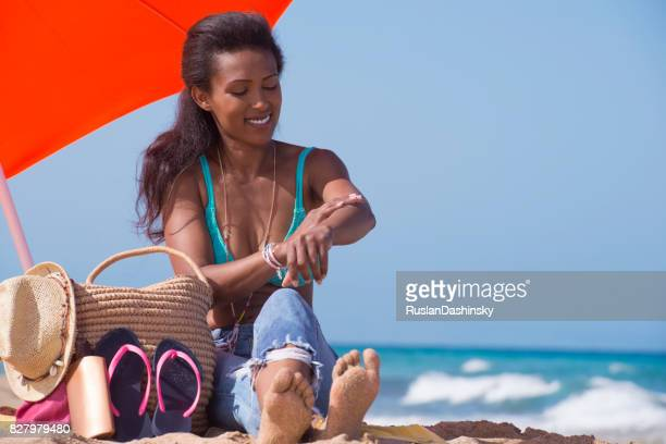Woman skin protection on the beach.