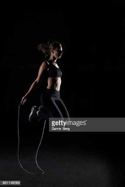 Woman skipping in gym