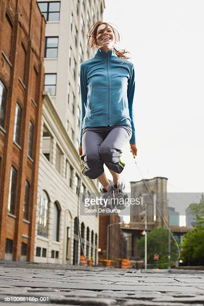 Woman skipping in urban environment