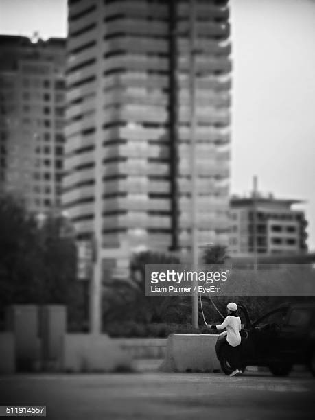 woman skipping rope with building in background - skipping along stock photos and pictures