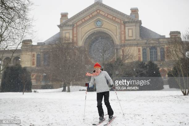 A woman skis down a hill in Alexandra Palace north London on March 1 2018 Fresh heavy snowfalls and icy blizzards were expected to lash Europe...