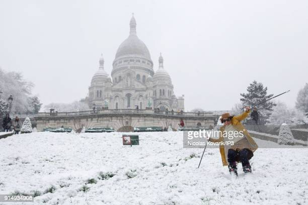 A woman skis on Montmartre Hill near the Sacre Coeur during a snowfall on February 6 2018 in Paris France Several french departments are affected by...