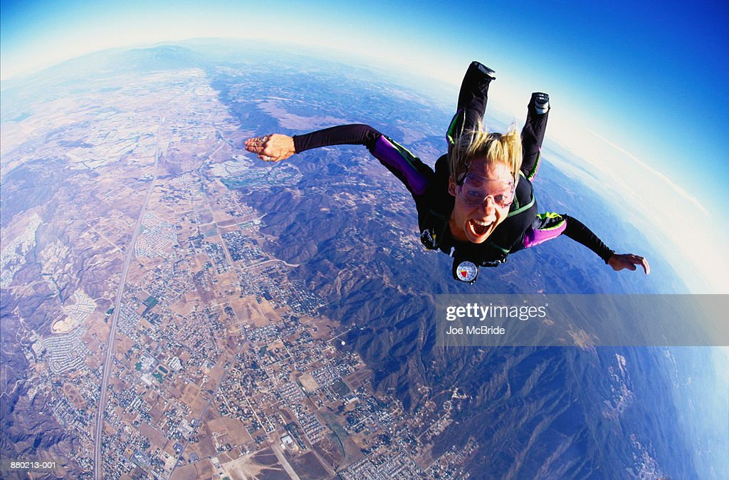 Woman skydiving, aerial view, California, USA (wide angle) : Stock Photo