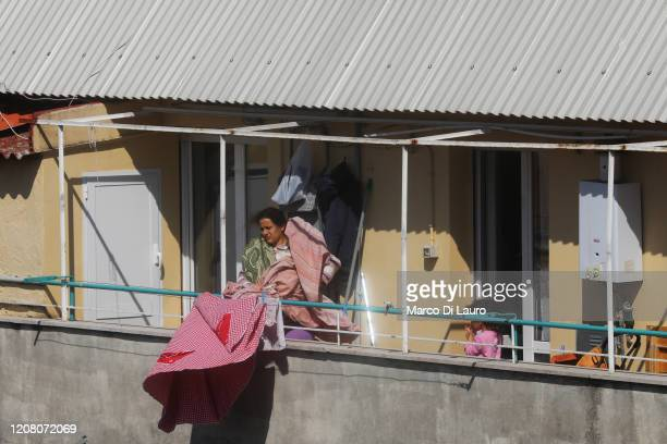 A woman slams her sheets on the balcony during lockdown on March 23 2020 in Rome Italy As Italy extends its nationwide lockdown to control the spread...
