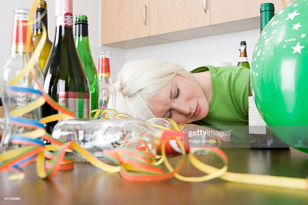 Woman sleeping after a party : Stock Photo