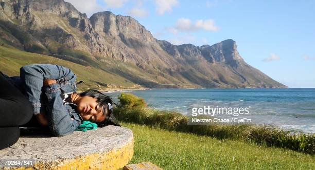 Woman Sleeping By Sea