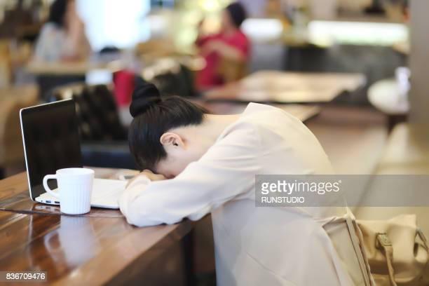 Woman sleeping in a coffee shop