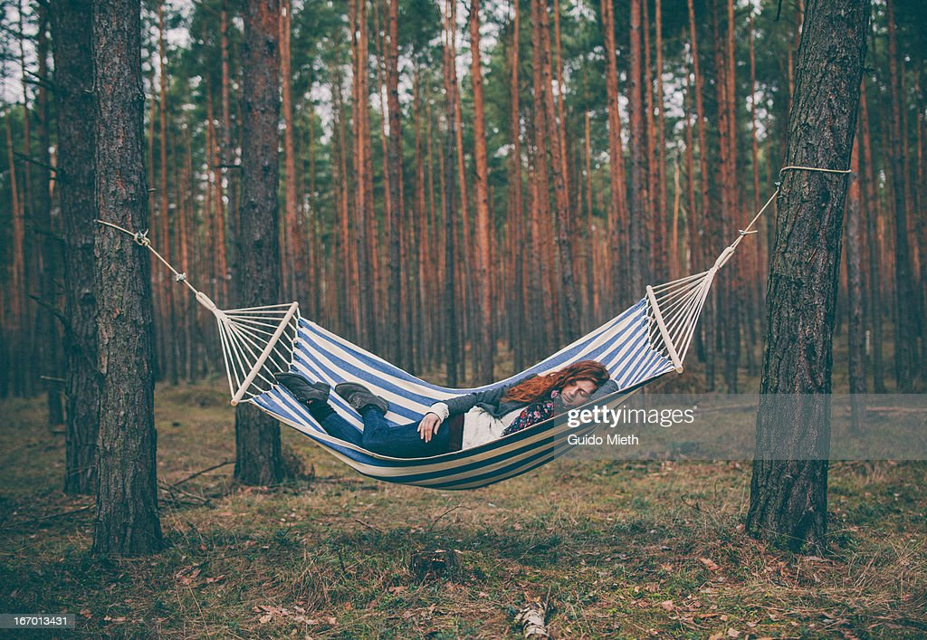 Woman sleeping in a hammock in the wood. : Stock Photo