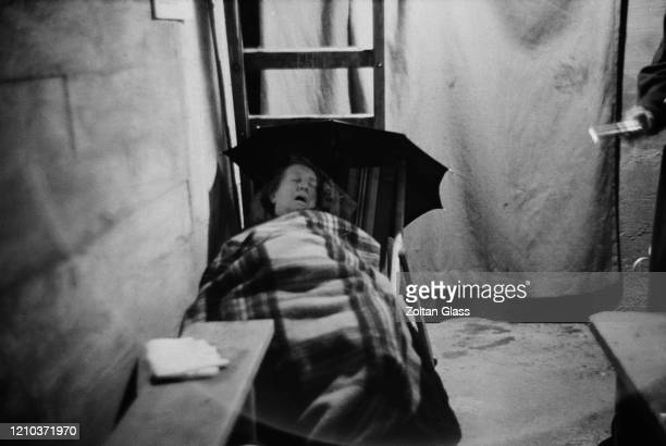 A woman sleeping in an air raid shelter during the Blitz London October 1940 Original Publication Picture Post 308 Shelter Life pub 26th October 1940