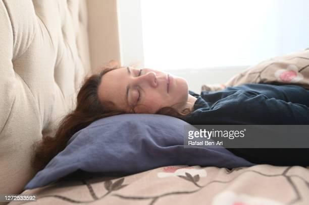 woman sleeping in bed - rafael ben ari ストックフォトと画像