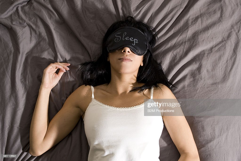 Woman sleeping in bed : Foto stock