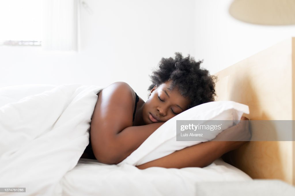 Woman sleeping in her bed at home : Stock Photo