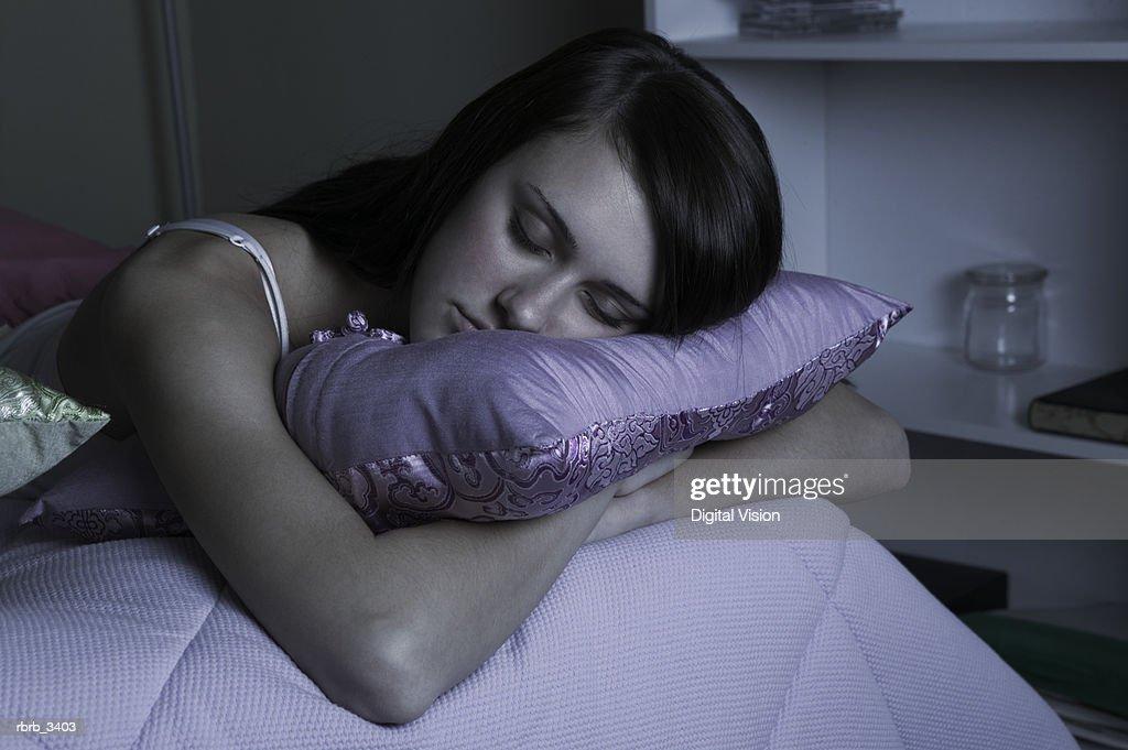 Woman sleeping on a bed : Foto de stock