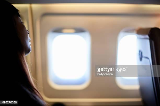 woman sleeping airplane