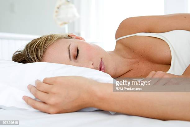 woman sleeping on bed - beautiful woman stock pictures, royalty-free photos & images