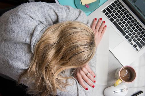 Woman sleeping on desk - gettyimageskorea