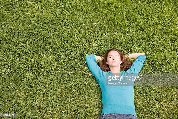 woman sleeping on grass - lying down stock pictures, royalty-free photos & images