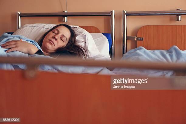 Woman sleeping on hospital bed