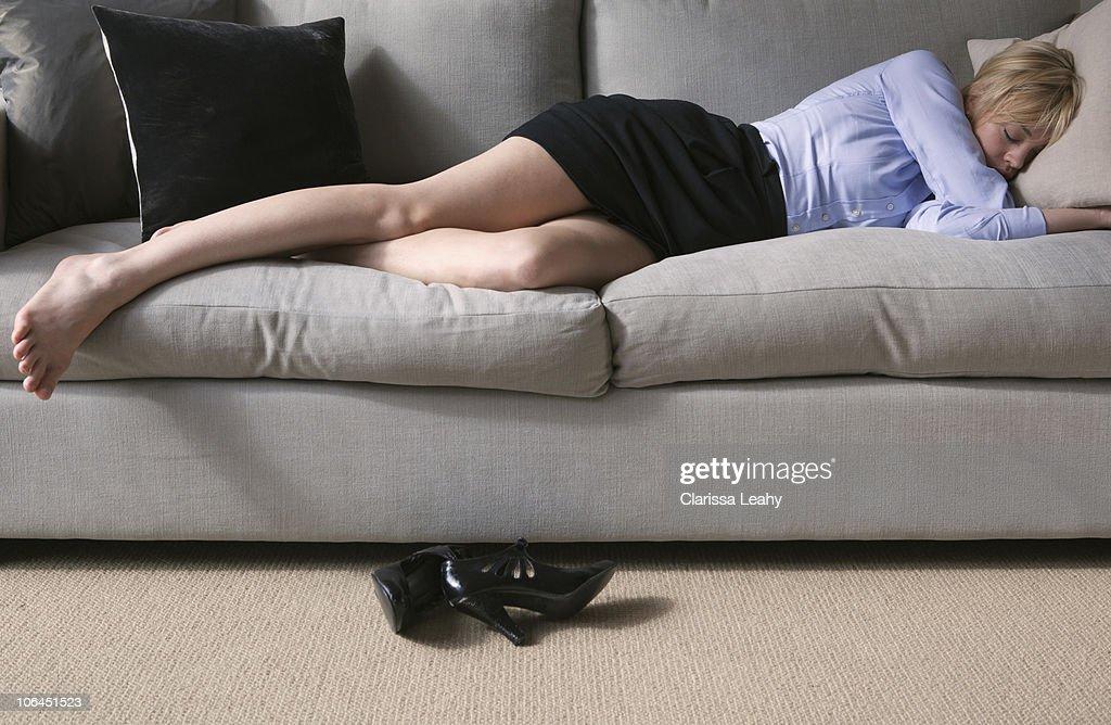 Woman sleeping on sofa : Stock Photo