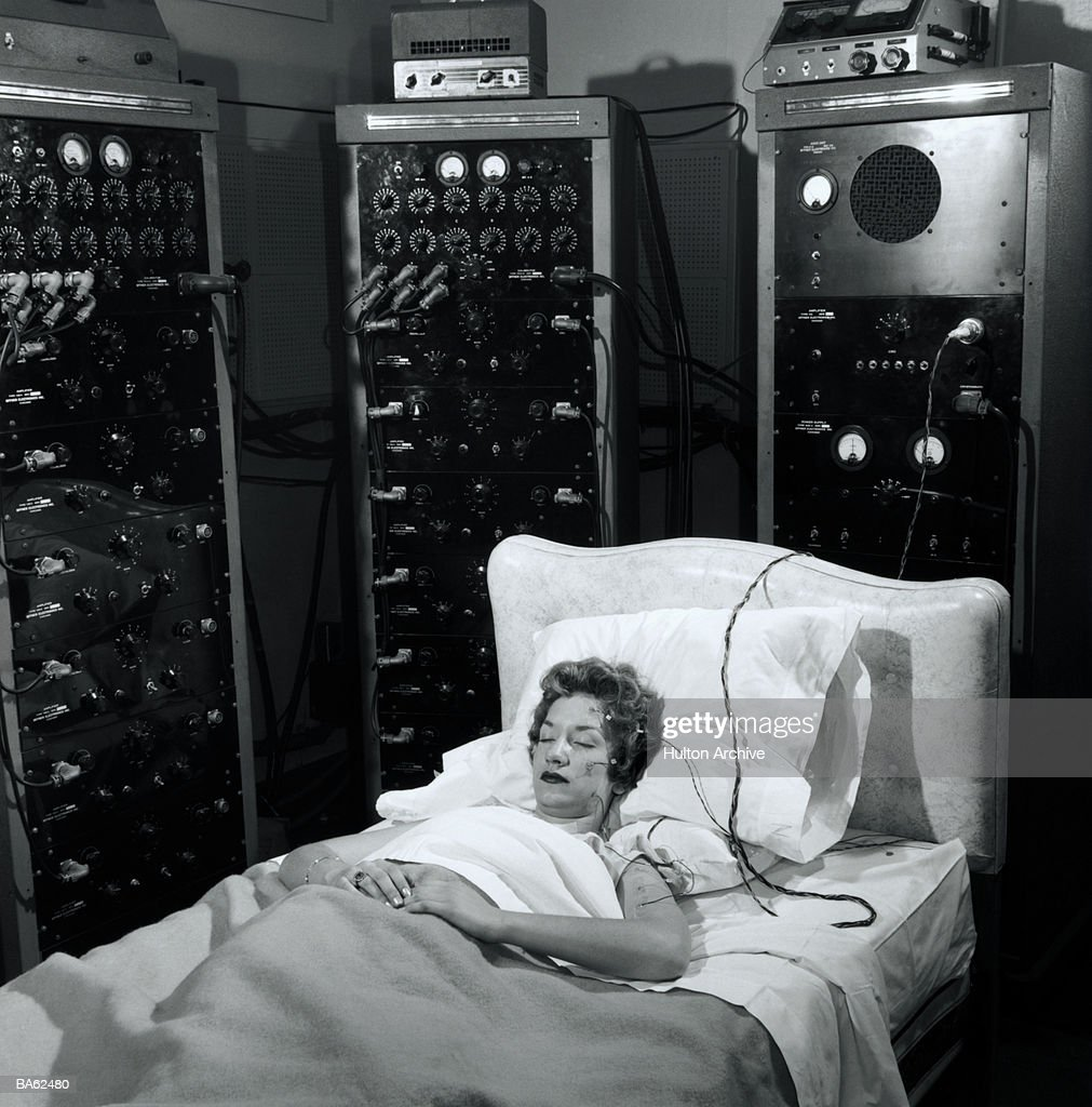 Sleep tests being carried out by The US Testing Company under supervision of psychologists and physiologists. Heart beat, blood pressure and brain activity is being recorded. circa 1955