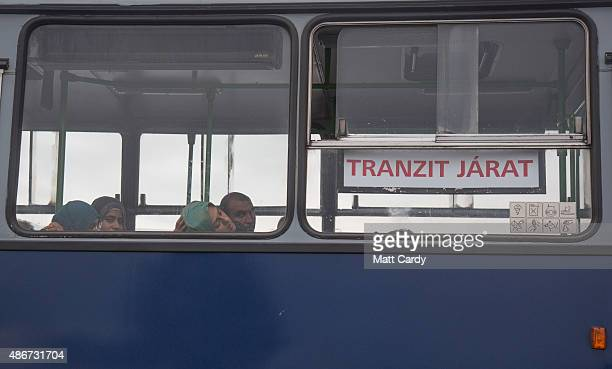A woman sleeps on a bus that is queuing to cross the border from Hungary into Austria on September 5 2015 near Nickelsdorf Austria Last night the...