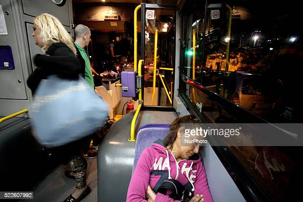 A woman sleeps on the bus in Athens April 19 2016